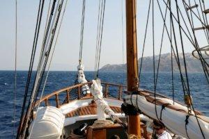 wooden boat sailing santorini