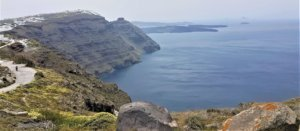 looking back to imerovigli on santorning caldera cliff-top hike from fira to oia