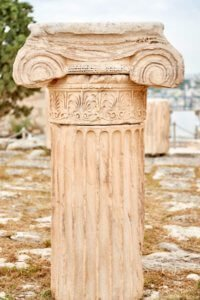 Beige concrete pillar seen when visiting the Acropolis