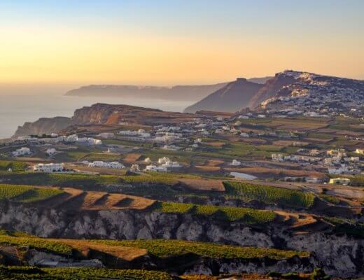 Landscape view of fields, vineyards and Santorini wineries, greece