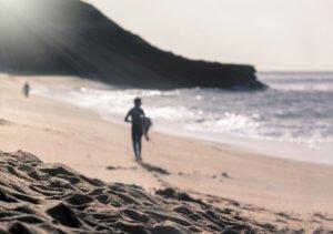 Surfer at bells beach, torquay on great ocean rd