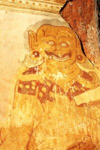 Old fresco with evil spirit-keeper image on stucco wall, Nanpaya temple, Bagan, Myanmar (Burma)