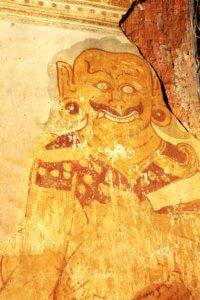 Old fresco with evil spirit-keeper image on stucco wall, Nanpaya temple, Bagan, Myanmar (Burma)