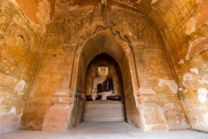 Buddha statue and paintings inside Thambula Pahto Temple, Bagan in Myanmar.