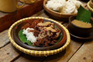 Nasi Gudeg, the Traditional Javanese Rice Dish with Jackfruit Stew, White Chicken Curry and Spicy Cattle Skin Stew