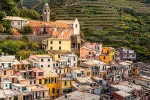 Vernazza village With San Francesco Church. Hill slope with vineyards, Cinque Terre coastal area. Liguria region in Italy.