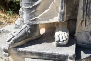Sandal on stone sculpture in Ancient Corinth Greece, Europe